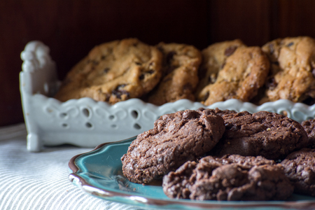 Close up of homemade chocolate, choc chip cookies on a plate Stock Photo