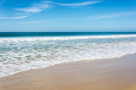 Waves breaking on beach with blue sky - Port Elizabeth, South Africa