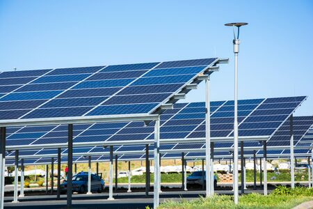 Roodepoort, South Africa - September 13, 2018: New solar panel carports in the parking lot of the Makro store Editorial
