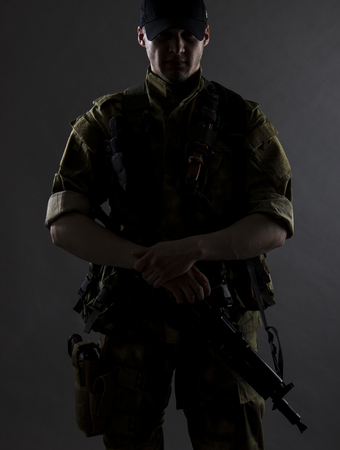 A military portrait. The military man is standing with gun. Stock Photo - 80429944