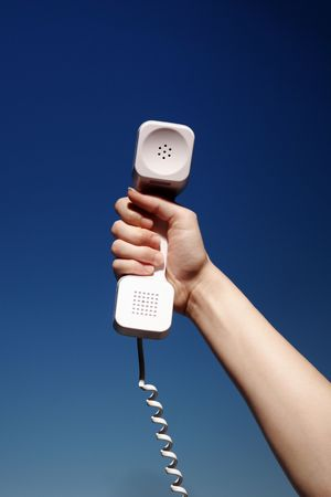 handset: Womans Hand Holding White Telephone Handset, Communications, Business, Sales