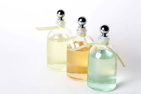 volatile: Essential Oils in Clear Bottles on White Background. Stock Photo