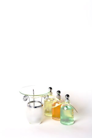 High Key Lighting, Essential Oils in Clear Bottles and Burner. Off-set for your message at the top.