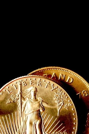 Gold Coins on Black Background photo
