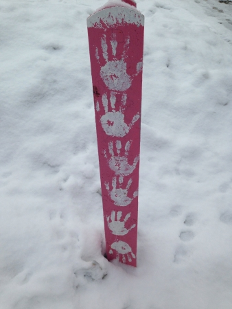 handprints: White handprints on post with snowy background