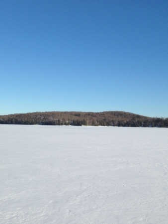 frozen lake: Snow covered frozen lake on a sunny day in Ontario in Haliburton ontario