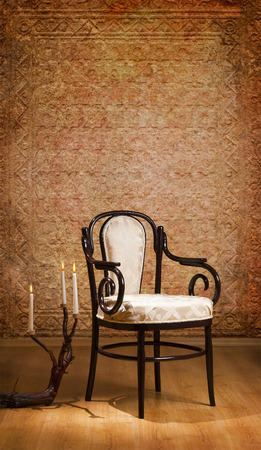 vintage chair and candles in the dark room with space for text