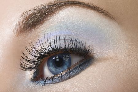 Beautiful woman`s open eye. Light blue and silver eye-shadows. Stock Photo - 1328837