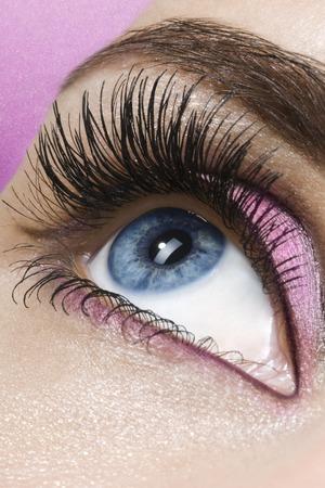 Beautiful woman`s open eye. Pink eye-shadows. Stock Photo - 1613776