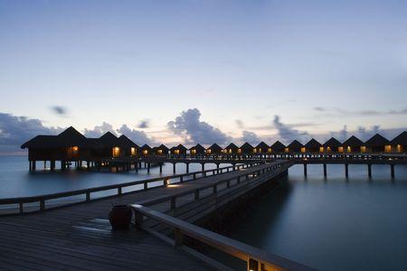 Sunset over water villas Stock Photo - 2420329