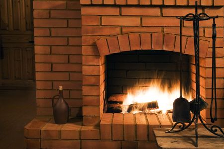 stone fireplace: View on a fireplace Stock Photo