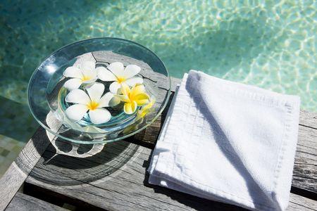 swimmingpool: Flowers in water on wooden floor near the swimmingpool