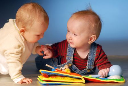 babies playing: Babies playing with toys