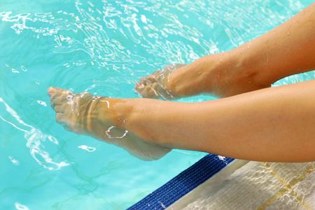 Legs in the water photo