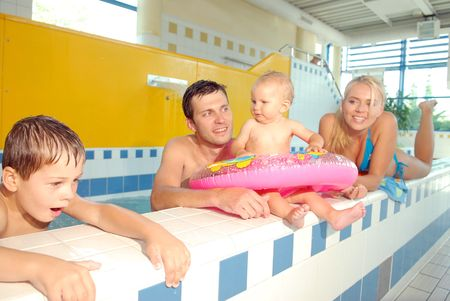 mammy: A family in the swimming pool Stock Photo