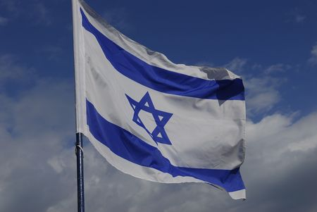 billowing: An Israeli flag billowing in the wind