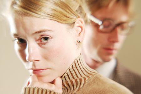 A sad young pretty blonde woman