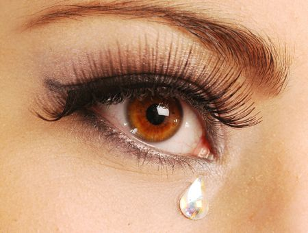 tear: A very sad eye of young woman Stock Photo
