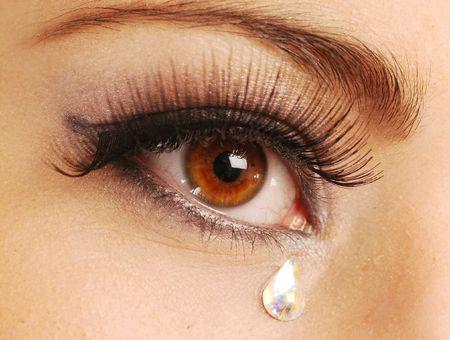 larmes: Une tr�s triste de la jeune femme des yeux Banque d'images