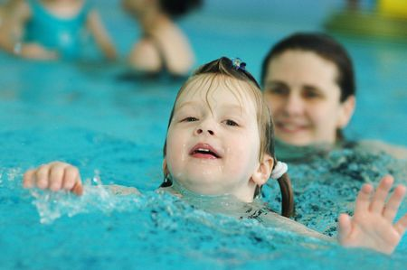 mammy: A little girl learning to swim