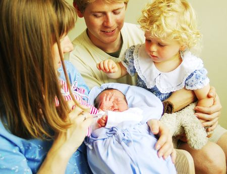 mammy: A happy family with newborn baby in hospital