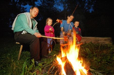 A family sitting at campfire Stock Photo