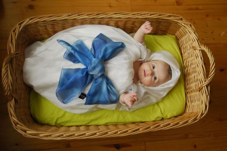 topknot: A little baby in a basket Stock Photo