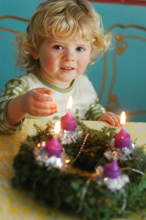 Child with an Advent wreath photo