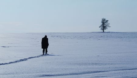 A person on a snowy field photo
