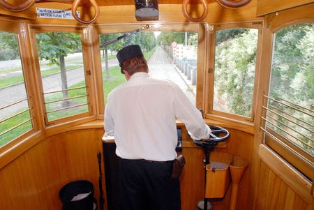 tramcar: A driver of the historical Prague tram