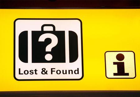 났습니다: Sign in airport hall with direction to information and lost found
