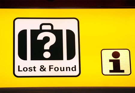 Sign in airport hall with direction to information and lost found