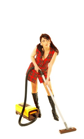 Woman with a vacuum cleaner photo