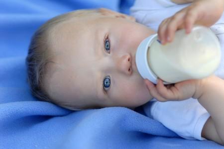 Child with a bottle of milk Reklamní fotografie