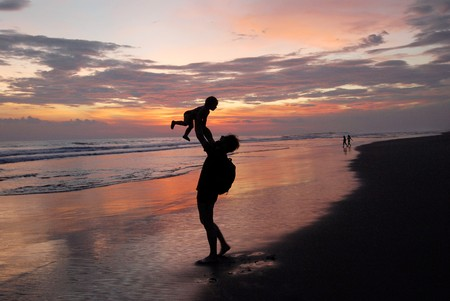 The father with daughter on the beach. photo