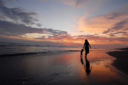 The mother with daughter on the beach.