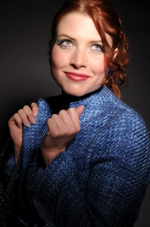 The attractive redhead woman in blue coat. photo