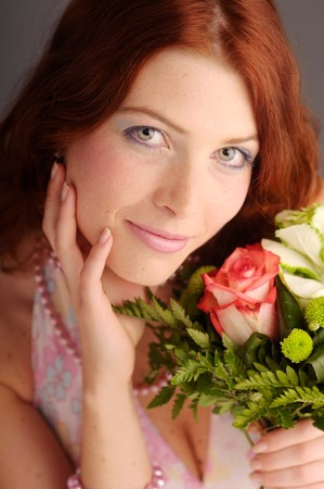 joyousness: The young redhead attractive woman with rose.