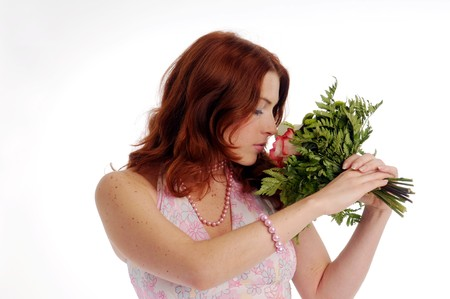 olfaction: The young redhead attractive woman with rose.
