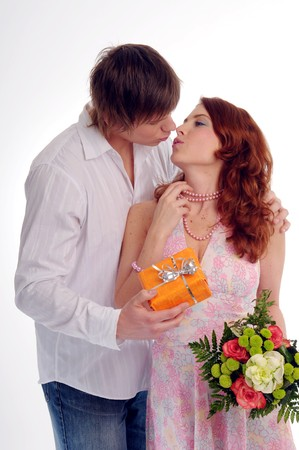 favour: The young couple with spray and gift.