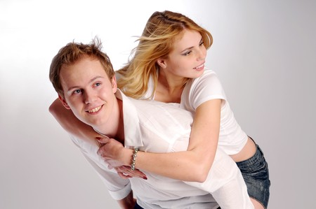 joyousness: The portrait of young attractive pair in love. Stock Photo