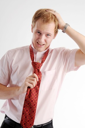 The young attractive blond businessman with red tie. photo