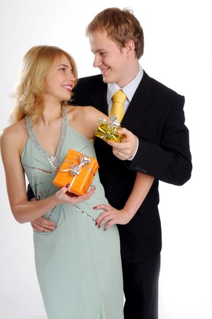favour: The young attractive pair in love with gift.