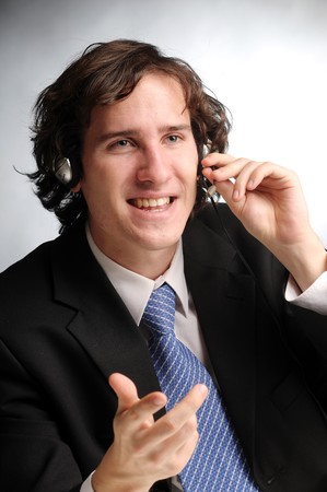 The portrait of young attractive phoned businessman. photo