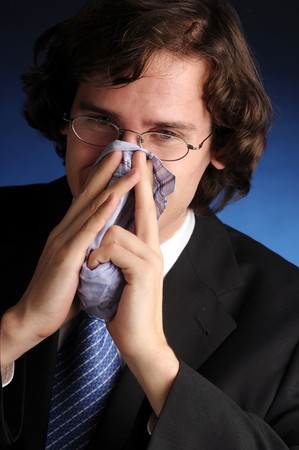The portrait of young attractive businessman with handkerchief. photo