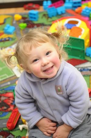 smiled: The portrait of little blond smiled girl.