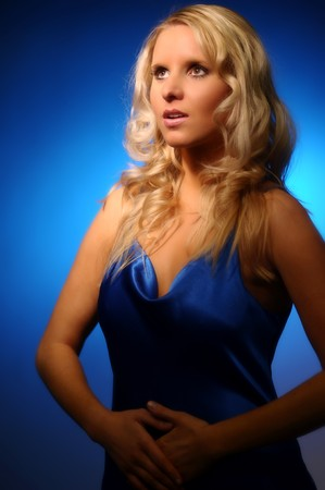 The portrait of young attractive blond woman. Stock Photo - 4116074