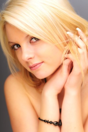 The portrait of young attractive blond woman. photo