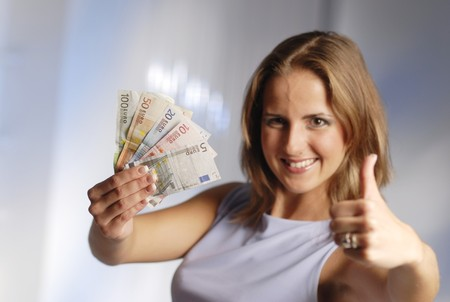 joyousness: The young attractive woman with the euro banknotes.