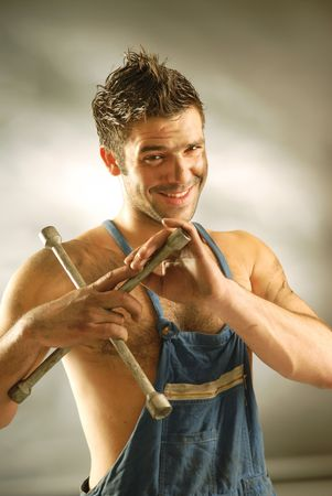 giggle: An auto-mechanic with a cross spanner.